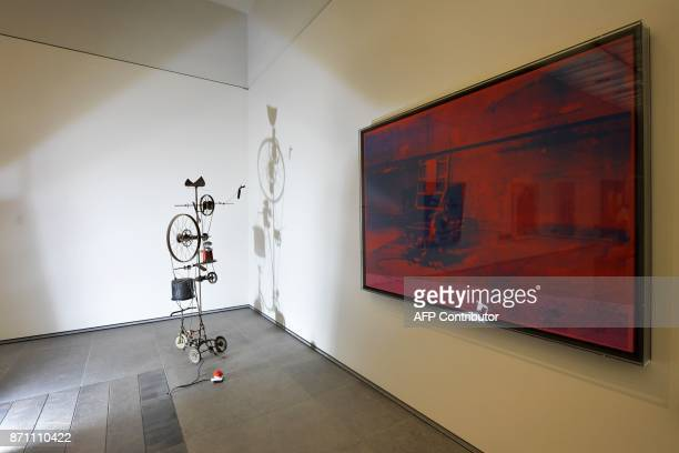 A painting titled 'Big Electric Chair' by American artist Andy Warhol is displayed at the Louvre Abu Dhabi Museum during a media tour on November 6...