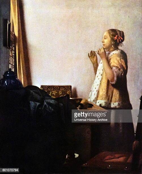 Painting titled 'The Pearl Necklace' by Johannes Vermeer a Dutch painter specialising in domestic interior scenes Dated 17th Century