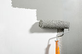 Close-up of paint roller on the wall.