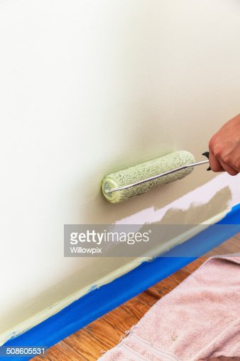 Painting Wall With Roller Near Floor : Stock Photo