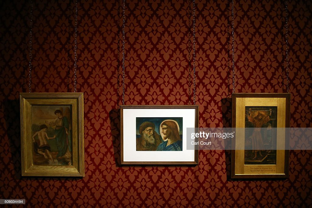 Paintings by (L-R) William De Morgan titled 'Tobias and the Angel at the River Tigris', 'Christ and Peter' by Simeon Solomon and 'The Wine Press' by John Roddam Spencer Stanhope are pictured during a preview at Leighton House Museum on February 10, 2016 in London, England. The worst form part of the Pre-Raphaelites on Paper exhibition, which will run from 12th February to 29th May 2016.