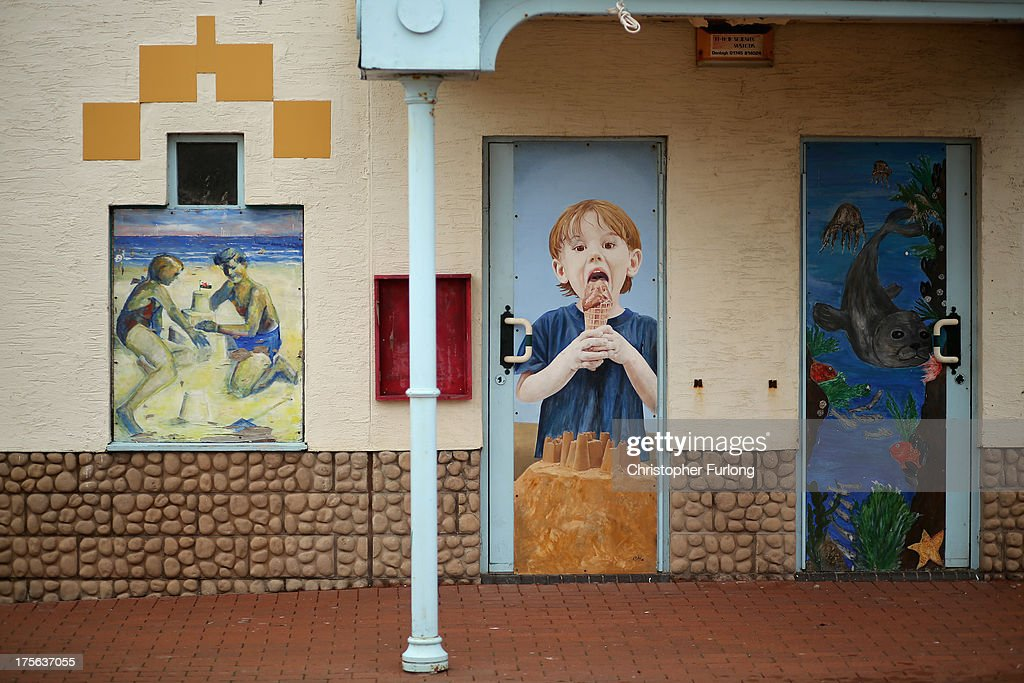 Paintings decorate a closed shop on Rhyl Promenade on August 5, 2013 in Rhyl, Wales. The think tank The Centre for Social Justice (CSJ) has today said that some British seaside towns such as Rhyl in North Wales were becoming 'dumping grounds' for vulnerable people. The report 'Turning the Tide' has monitored conditions in five seaside towns, Rhyl in Denbighshire, Margate in Kent, Clacton-on-Sea in Essex, Blackpool in Lancashire and Great Yarmouth in Norfolk. In one area of Rhyl, over 66% of working-age people were found to be dependent on out-of-work benefits.