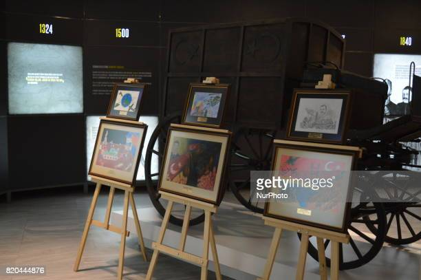 Paintings marking the 1st anniversary of Turkey's failed coup attempt are seen at the PTT Stamp Museum in Ankara Turkey on July 21 2017