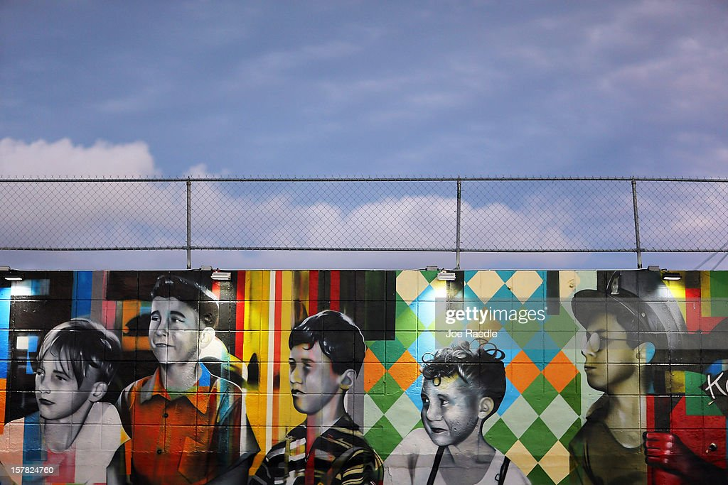 Paintings of children are seen on the wall of a building in the Wynwood Walls art project on December 6, 2012 in Miami, Florida. The art project along with many other satellite shows around the city coincide with the International art show, 'Art Basel', which runs until the 9th of December.