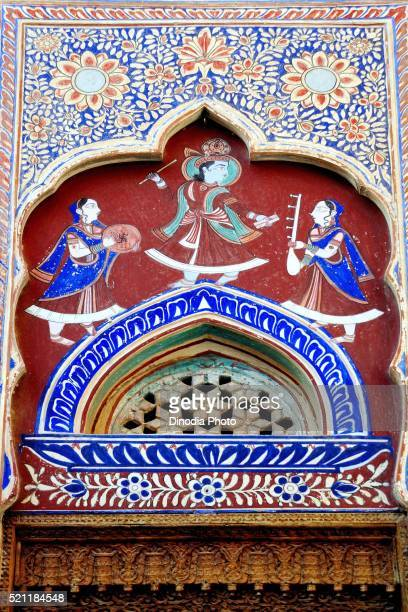 Paintings of lord krishna dancing with gopika on wall of haveli Fatehpur, Shekhawati, Rajasthan, India