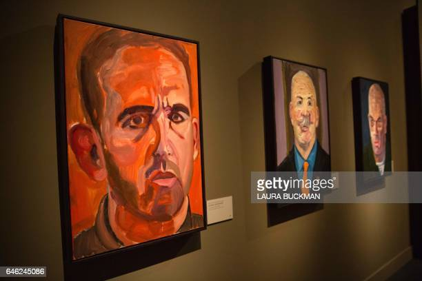 Paintings of wounded US military veterans painted by former US President George W Bush hang in 'Portraits of Courage' a new exhibit at the George W...