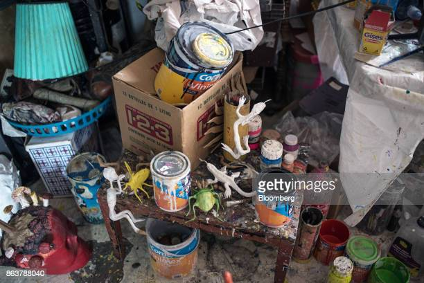 Paints and materials to create alebrijes Mexican folk art sculptures sit at a studio in Mexico City Mexico on Monday Oct 16 2017 The first alebrijes...