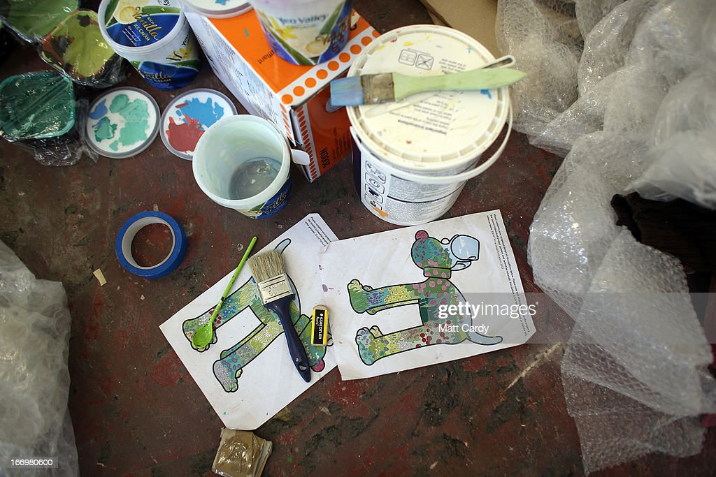 Paints and plans are seen near a Gromit sculpture, of around 70, some of which have been painted by celebrity artists, left to right, Sir Paul Smith, Cath Kidston, Richard Williams and Simon Tofield, are seen before they are placed around the city for public view as part of charity initiative arts trail, on April 19, 2013 in Bristol, England. After being displayed to the public from July 1, the sculptures will be eventually auctioned off to raise funds for the Bristol Children's Hospital charity, Wallace & Gromit's Grand Appeal.