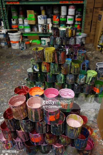Paints cans sit on the floor of Colossal Media August 2 in New York Colossal Media specializes in hand painted ads in New York and across the United...