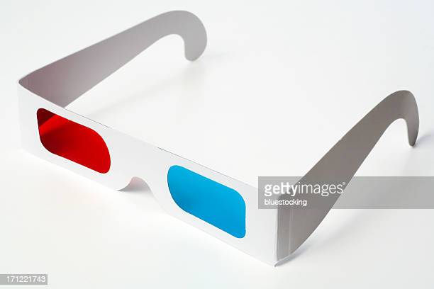 A pair of 3D glasses, white, with one blue and one red lens