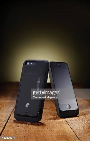 A pair of Apple iPhone 5's fitted with PowerSkin battery case taken on March 21 2013