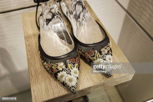 A pair of 'ballet pumps in dotted Swiss tulle and embroidery' sit on display at a Christian Dior SE store in Shanghai China on Saturday June 10 2017...