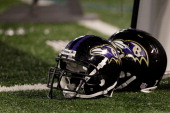 A pair of Baltimore Ravens helmets sit on the sidelines during the Ravens game against the Washington Redskins at MT Bank Stadium on August 25 2011...
