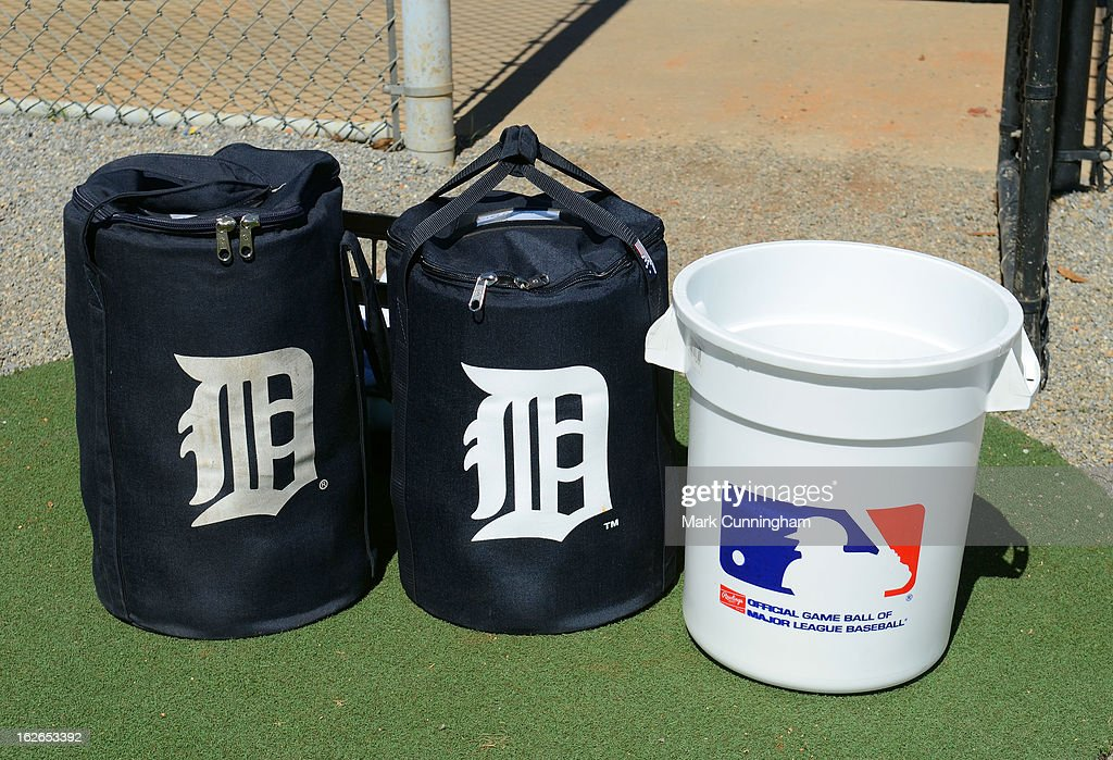 A pair of baseball equipment bags and a bucket sit on the field during the Detroit Tigers Spring Training workouts at the TigerTown Facility on February 18, 2013 in Lakeland, Florida.