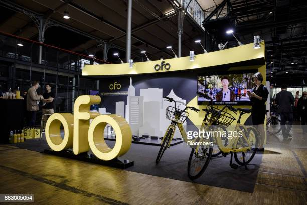 A pair of bicycles sit on a display on the Ofo Inc hire bicycle exhibition stand at the Autonomy urban mobility summit in Paris France on Thursday...