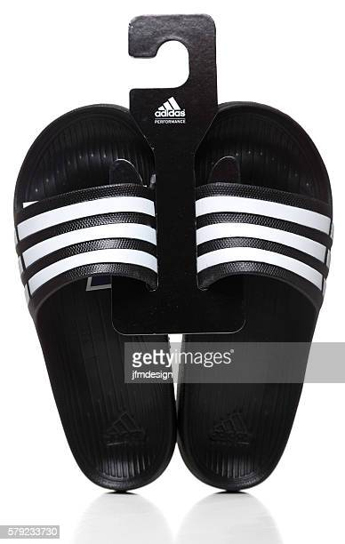 Pair of black Adidas Slide sandals