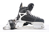 A pair of black and silver ice skates on a white background