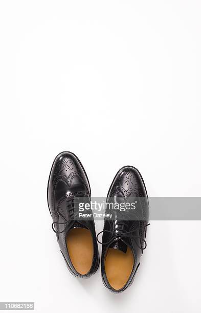 Pair of black brogue shoes with copy space