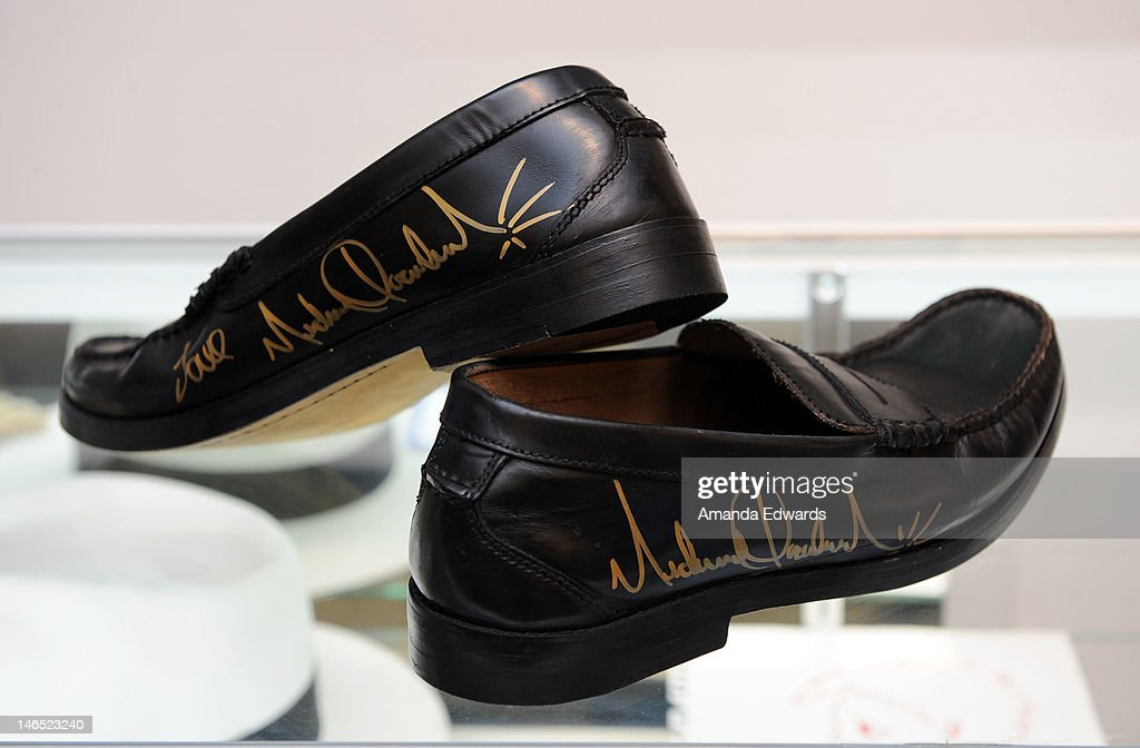 A pair of black leather loafers signed by singer Michael Jackson is displayed at the Julien's Auctions press call for Music Icons And Sports Legends Memorabilia Auction at Julien's Auctions Gallery on June 18, 2012 in Beverly Hills, California.