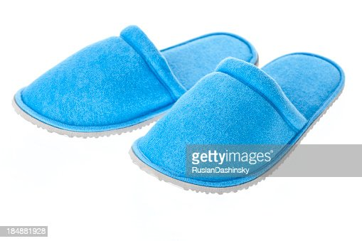 Pair of blue house shoes on white background