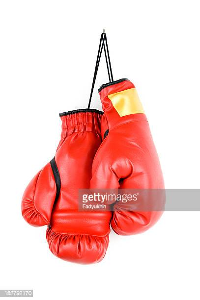 Pair of bright red boxing gloves hanging up