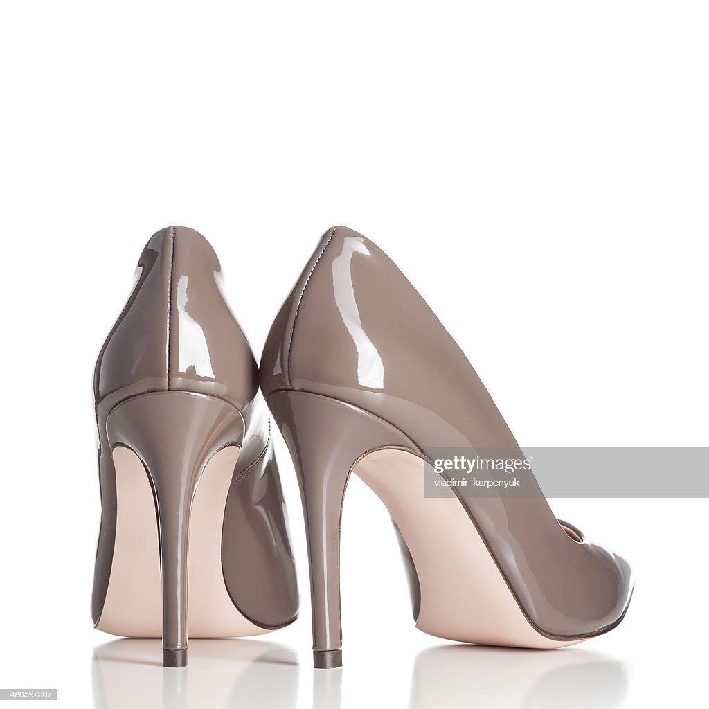 pair of brown female high heel shoes : Stock Photo