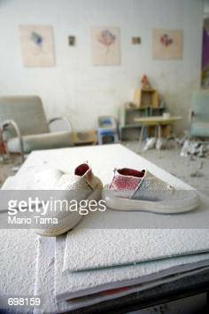 A pair of childrens shoes covered in dust stand on a table in a building near 'ground zero' September 13 2001 two days after two hijacked airplanes...
