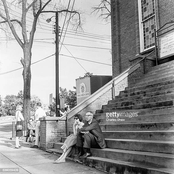 A pair of Civil Rights activists sit on the steps of the Dexter Avenue Baptist Church on the day before the Selma to Montogmery March arrived at the...