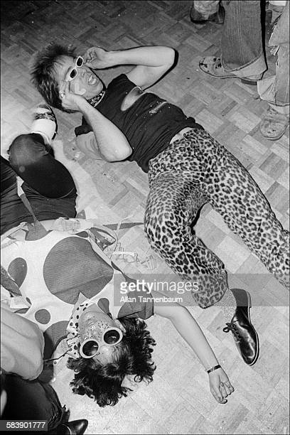 A pair of clubgoers dressed as punks lie on the floor at Studio 54's third annual Halloween party New York New York October 31 1978