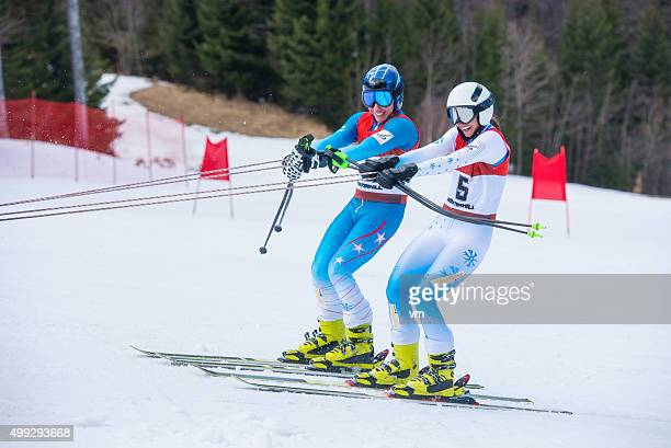 Pair of competitive skiers on a ski lift