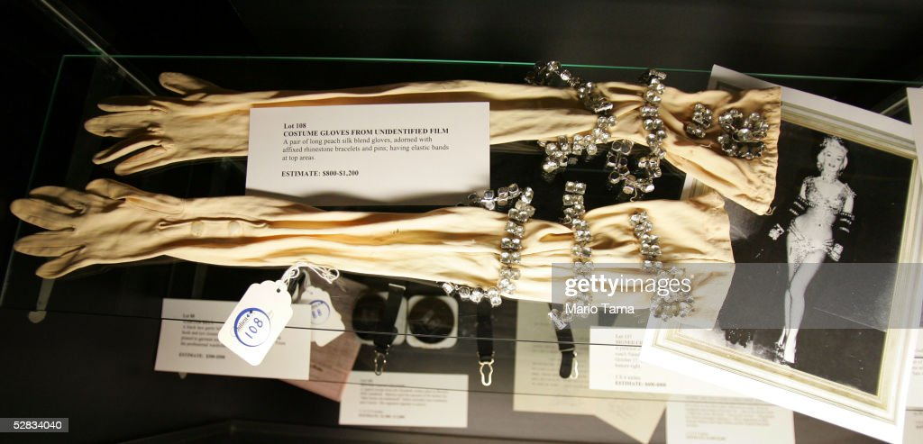 A pair of costume gloves from the estate of actress Marilyn Monroe are seen during a press preview in Planet Hollywood May 16, 2005 in New York City. Over 200 personal and professional items will be offered in the June 4th sale.