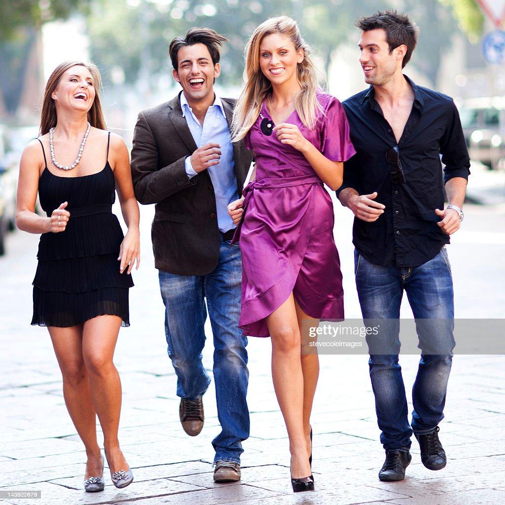 Pair Of Couple Running On Street : Stock Photo