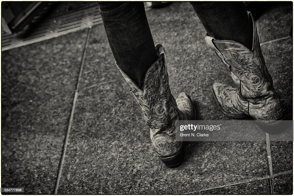 A pair of cowboy boots are seen during recording artist Dustin Lynch's performance at the 'FOX & Friends' All American Concert Series outside of FOX Studios on May 27, 2016 in New York City.