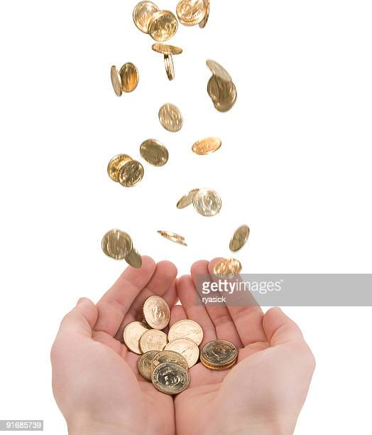 Pair of Cupped Hands Catching Falling Money Gold Coins Isolated