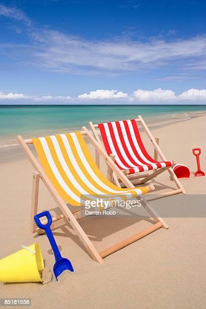 Pair of deckchairs on tropical beach