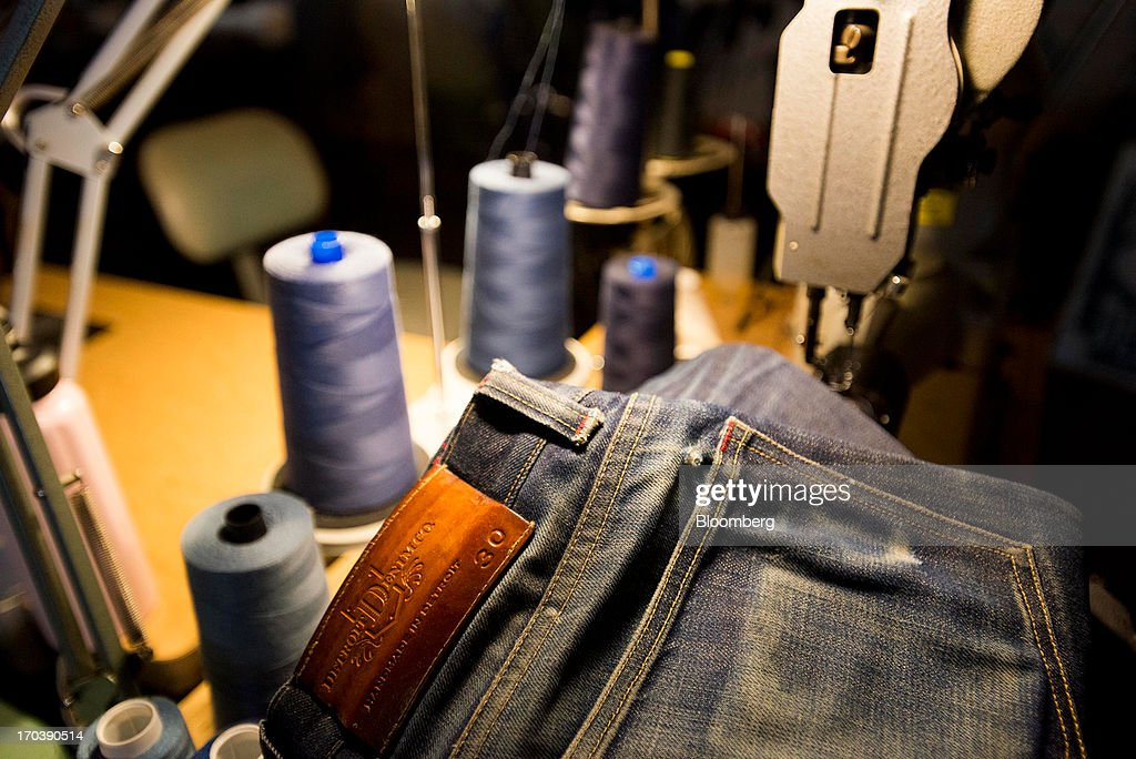 A pair of denim jeans sits on a sewing machine waiting to be finished at Detroit Denim, in Detroit, Michigan, U.S., on Wednesday, June 12, 2013. The Commerce Department is scheduled to release monthly business inventories data on June 13. Photographer: Ty Wright/Bloomberg via Getty Images