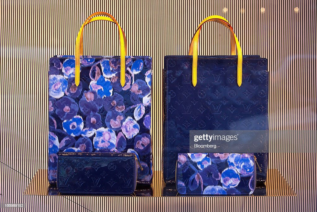 A pair of designer bags by Louis Vuitton, a unit of LVMH Moet Hennessy Louis Vuitton SA, are seen in the window of the KaDeWe, or Kaufhaus des Westens department store in Berlin, Germany, on Thursday, April 18, 2013. Germany's economy is shrugging off a contraction at the end of last year and starting to grow due to revived exports and rising private consumption, the country's leading economic institutes said. Photographer: Krisztian Bocsi/Bloomberg via Getty Images