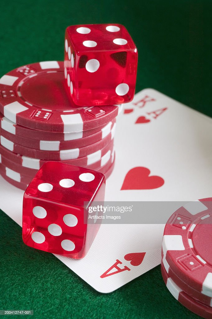Pair of dice and gaming chips on playing cards, close-up : Stock Photo
