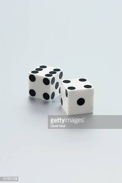 Pair of dice on white background, close-up