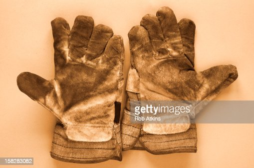 Pair of dirty work gloves : Stock Photo