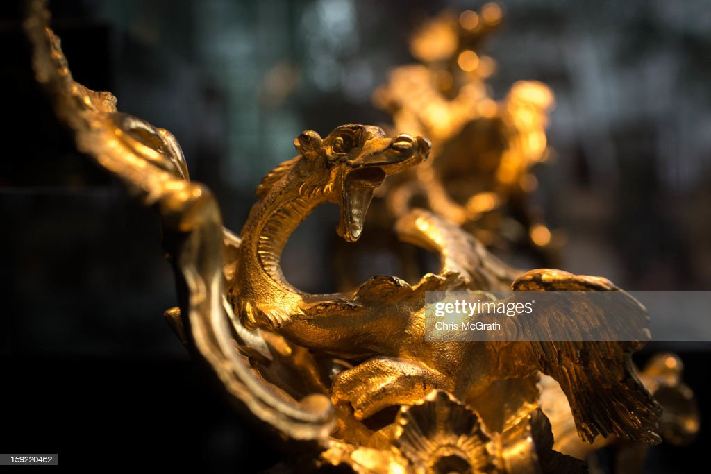 A pair of dragon chased and gild bronze fire dogs from circa 1720 is seen on display at Marina Bay Sands in Singapore. To commemorate the Year of The Dragon,the exhibition 'The Final 100 Days of the Year of the Dragon' showcases a selection of rare 18th century French 'Chinoiserie' furniture and ornaments from the Kraemer gallery collection in Paris. The Kraemer Gallery boasts the worlds largest privately-owned collection of French 18th century furniture and ornaments considered museum quality. The exhibition is on display until Chinese New Year on 10 February 2013.