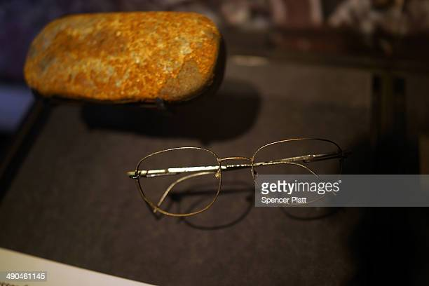 A pair of eye glasses recovered from Ground Zero are viewed during a preview of the National September 11 Memorial Museum on May 14 2014 in New York...