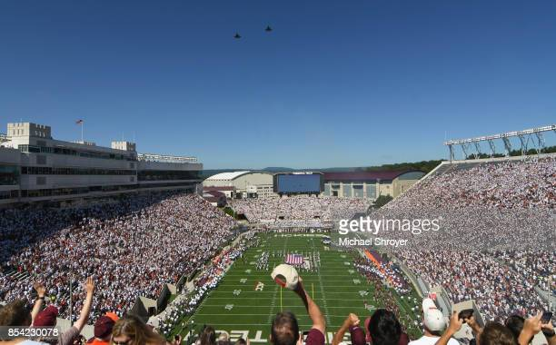 A pair of F22 Raptors fly over Lane Stadium prior to the game between the Virginia Tech Hokies and the Old Dominion University Monarchs on September...