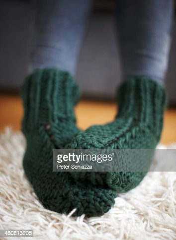 Pair of feet in green knitted socks