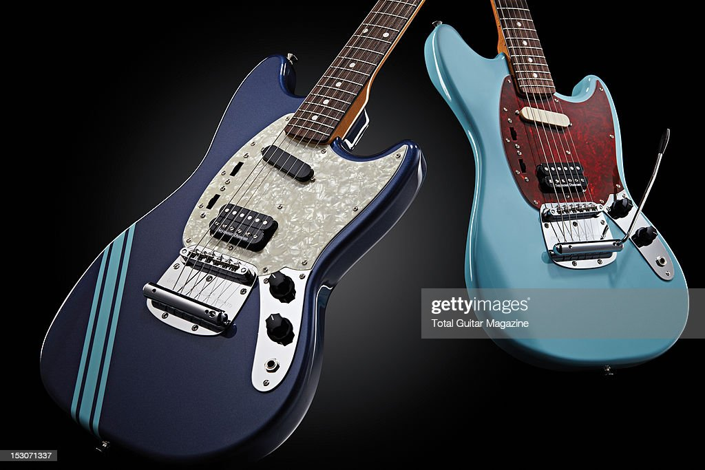 A pair of Fender Kurt Cobain Mustang electric guitars in Dark Lake Placid Blue (L) and Sonic Blue finishes, photographed during a studio shoot for Total Guitar Magazine, February 20, 2012.