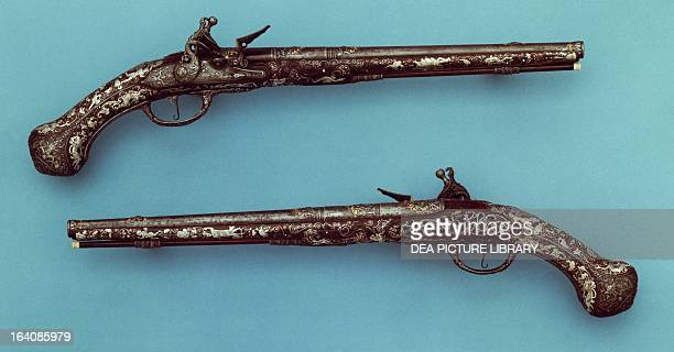 Pair of flintlock pistols with chiseled mounts ca 1695 Monlong inscription Londini London Royal Armouries National Museum Arms And Armour