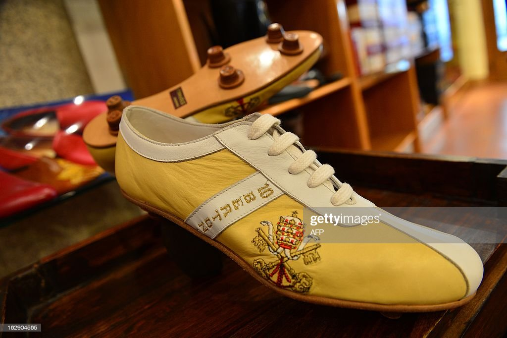 A pair of football shoes with the name of Cardinal Bertone, the number 10 and the Vatican's arms are displayed on March 1, 2013 in Papal shoemaker Adriano Stefanelli's shop in Novara. Papal shoemaker Adriano Stefanelli, who made shoes for Popes John Paul II and Pope Benedict XVI, is also expected to have the next Pope as a customer.
