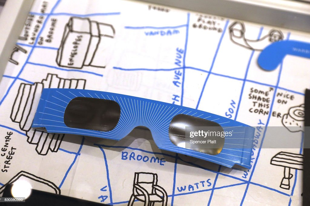 A pair of free solar eclipse glasses sit on display at a Warby Parker store on August 11, 2017 in New York City. To view the upcoming total solar eclipse on August 21 eye protection is essential. The designer eyeglass store expects to give out thousands of pairs of the glasses before the event.