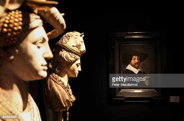 A pair of French carved wooden busts from the 18th century stand next to Frans Hals' 'Portrait d'homme tenant un livre' on January 29 2009 at...