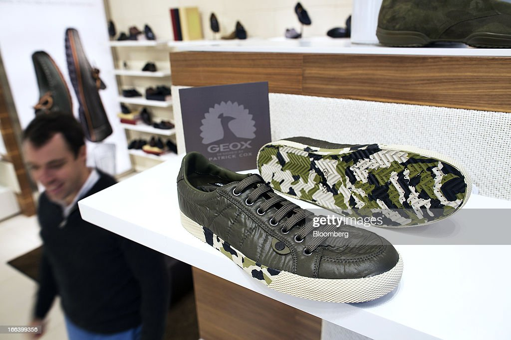 A pair of Geox SpA shoes designed by Patrick Cox are displayed for sale inside the company's flagship store in the Central district of Hong Kong, China, on Friday, April 12, 2013. Hong Kong's economy expanded 1.4 percent in 2012 and Financial Secretary John Tsang is projecting growth of 1.5 percent to 3.5 percent this year. Photographer: Jerome Favre/Bloomberg via Getty Images
